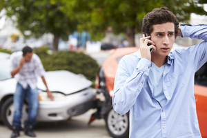 Man on the phone in a car accident