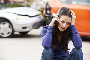 Woman Calling in Accident